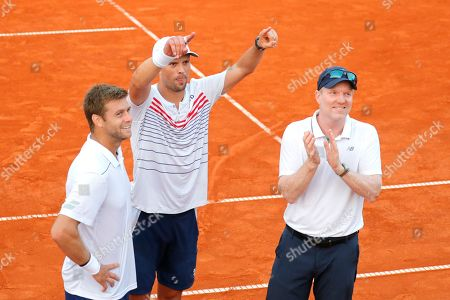Mike Bryan (C)  and Ryan Harrison. (L) and their Head Coach Jim Courier (R)  of USA celebrate their victory in the double match for the Davis Cup semi final tie between Croatia and the USA in Zadar, Croatia, 15 September 2018.