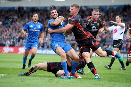 Leinster vs Dragons. Leinster's Rob Kearney tackled by Jack Dixon and Adam Warren of the Dragons