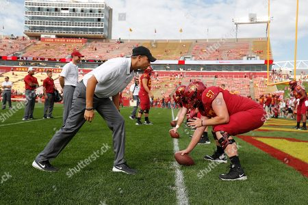 Matt Campbell, Colin Newell. Iowa State head coach Matt Campbell, left, and offensive lineman Colin Newell, right, run drills during warm ups before an NCAA college football game against Oklahoma, in Ames, Iowa