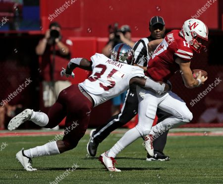 Andrew Bunch, Tyler Murray. Troy defensive back Tyler Murray (35) sacks Nebraska quarterback Andrew Bunch (17) during the first half of an NCAA college football game in Lincoln, Neb