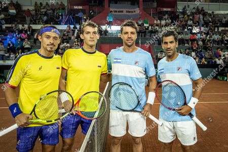From left to right,Cristian Rodriguez, Alejandro Gomez, both of Colombia, Horacio Ceballos and Maximo Gonzalez, both of Argentina, pose for a photo prior to their Davis Cup World Group play-off doubles tennis match in San Juan, Argentina