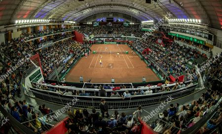 Colombia's Cristian Rodriguez serves to Argentina's Horacio Zeballos and Maximo Gonzalez during a Davis Cup world group play-off doubles tennis match at the Aldo Cantoni stadium in San Juan, Argentina