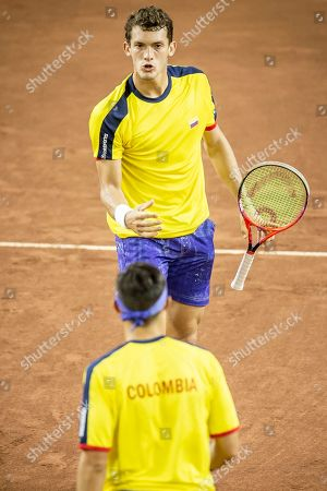 Colombia's Alejandro Gomez celebrats with teammate Cristian Rodriguez winning a point over Argentina's Horacio Zeballos and Maximo Gonzalez during their Davis Cup world group play-off doubles tennis match in San Juan, Argentina