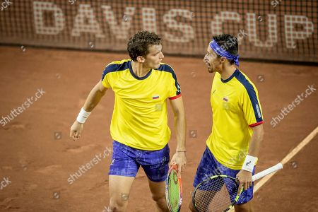 Colombia's Cristian Rodriguez, right, and Alejandro Gomez celebrate winning a point during their Davis Cup World Group play-off doubles tennis match against Argentina's Horacio Zeballos and Maximo Gonzalez in San Juan, Argentina