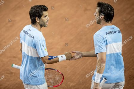 Argentina's Horacio Zeballos, right, and Maximo Gonzalez celebrate winning a point during their Davis Cup world group play-off doubles tennis match against Colombia's Cristian Rodriguez and Alejandro Gomez in San Juan, Argentina