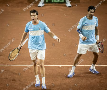 Argentina's Horacio Zeballos, left, and Maximo Gonzalez celebrates winning a point during their Davis Cup World Group play-off doubles tennis match against Colombia's Cristian Rodriguez and Alejandro Gomez in San Juan, Argentina