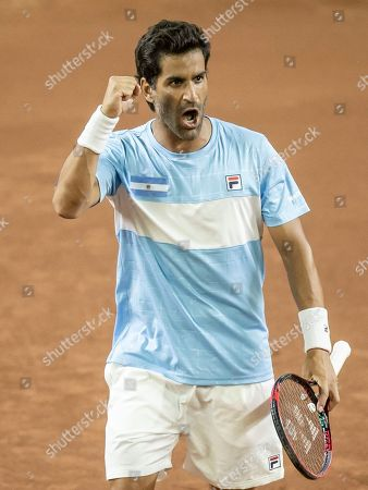 Argentina's Maximo Gonzalez celebrates winning a point during a Davis Cup World Group play-off doubles tennis match against Colombia's Cristian Rodriguez and Alejandro Gomez in San Juan, Argentina