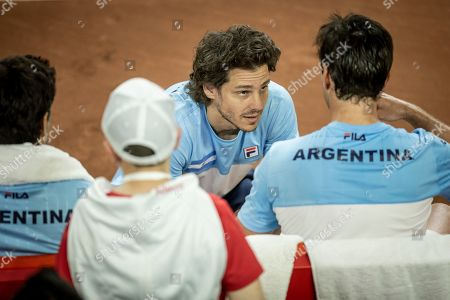 Argentina's team captain Gaston Gaudio talks to Horacio Zeballos during a Davis Cup World Group play-off doubles tennis match against Colombia's Cristian Rodriguez and Alejandro Gomez in San Juan, Argentina