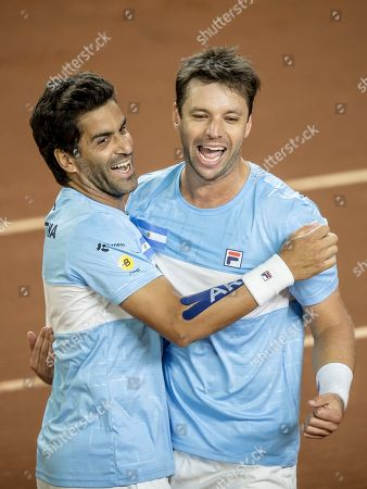 Argentina's Horacio Zeballos, right, and teammate Maximo Gonzalez celebrate beating Colombia's Cristian Rodriguez and Alejandro Gomez during their Davis Cup World Group play-off doubles rubber in San Juan, Argentina, . Argentina won 6-4, 7-6, 6-7, 4-6, 6-4 and secure a seeding for the qualifying round in next year's revamped tournament