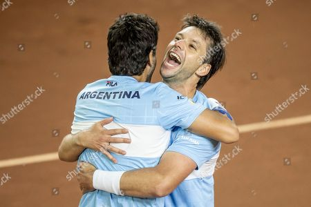 Argentina's Horacio Zeballos, right, and teammate Maximo Gonzalez celebrate beating Colombia's Cristian Rodriguez and Alejandro Gomez during their Davis Cup World Group play-off doubles rubber in San Juan, Argentina, . Argentina won 6-4, 7-6, 6-7, 4-6, 6-4 to seal an unassailable 3-0 lead and secure a seeding for the qualifying round in next year's revamped tournament