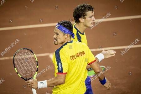 Colombia's Cristian Rodriguez, front, and Alejandro Gomez during their Davis Cup World Group play-off doubles rubber match against Argentina's Horacio Zeballos and Maximo Gonzalez in San Juan, Argentina, . Argentina won 6-4, 7-6, 6-7, 4-6, 6-4 to seal an unassailable 3-0 lead and secure a seeding for the qualifying round in next year's revamped tournament
