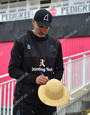 Sussex head coach Jason Gillespie signing a hat for a fan before the final of the Vitality T20 Finals Day 2018 match between Worcestershire Rapids and Sussex Sharks at Edgbaston, Birmingham