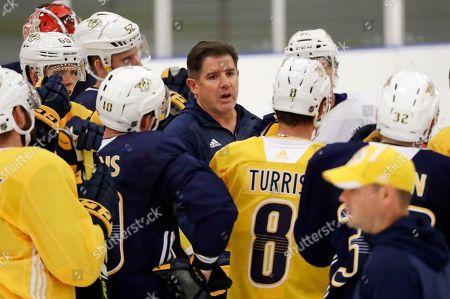 Nashville Predators head coach Peter Laviolette talks to his players during NHL hockey training camp, in Nashville, Tenn