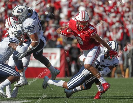 Wisconsin's Danny Davis III tries to get past BYU's Chris Wilcox during the first half of an NCAA college football game, in Madison, Wis