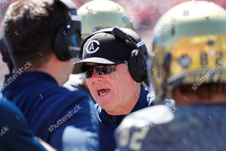 Tesla0824. UC Davis head coach Dan Hawkins talks to his players during a timeout in the second half in an NCAA college football game in Stanford, Calif