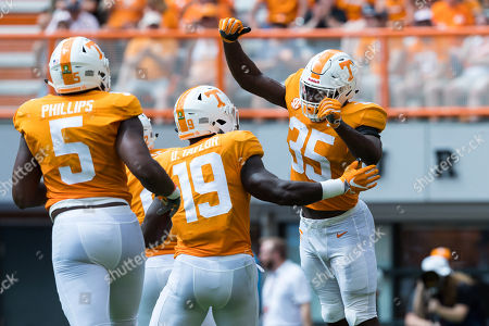 Daniel Bituli #35, Darrell Taylor #19 and Kyle Phillips #5 of the Tennessee Volunteers celebrate a defensive play during the NCAA football game between the University of Tennessee Volunteers and the University of Texas at El Paso Miners in Knoxville, TN Tim Gangloff/CSM