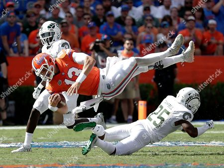 Feleipe Franks, Darius Campbell. Florida quarterback Feleipe Franks (13) is upended by Colorado State cornerback Darius Campbell (25) during the first half of an NCAA college football game, in Gainesville, Fla