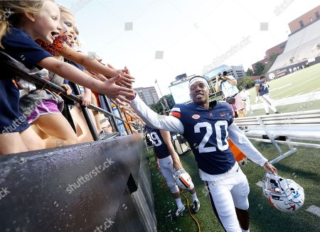 Virginia cornerback Nick Grant slaps hands with fans after an NCAA college football game against Ohio, in Nashville, Tenn. Virginia won 45-31. The game was played in Nashville because of Hurricane Florence