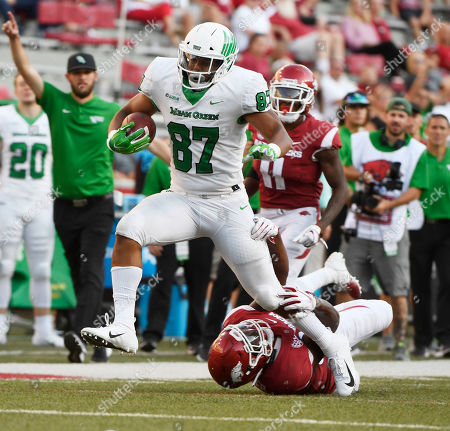 North Texas tight end Kelvin Smith (87) tries to shake Arkansas defender Dee Walker in the second half of an NCAA college football game, in Fayetteville, Ark