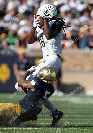 Vanderbilt wide receiver Chris Pierce (19) makes the catch as Notre Dame defensive back Troy Pride Jr. (5) defends during NCAA football game action between the Vanderbilt Commodores and the Notre Dame Fighting Irish at Notre Dame Stadium in South Bend, Indiana. Notre Dame defeated Vanderbilt 22-17
