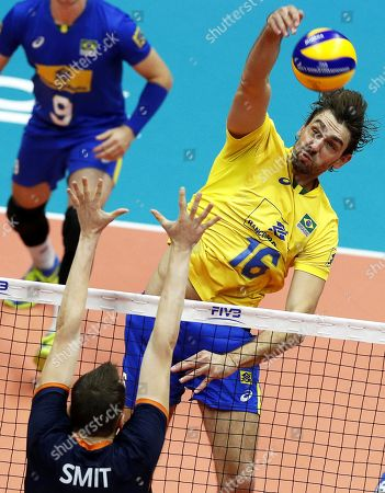 Stock Picture of Brazil's Lucas Saatkamp (R) in action against Tim Smit (L) of the Netherlands during the FIVB Men's World Championship First Round Pool B match between the Netherlands and Brazil in Ruse, Bulgaria, 15 September 2018.