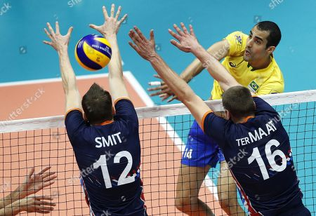 Brazil's Douglas Souza (back R) in action against Dutch players Tim Smit (L) and Wouter ter Maat (front R) during the FIVB Men's World Championship First Round Pool B match between the Netherlands and Brazil in Ruse, Bulgaria, 15 September 2018.