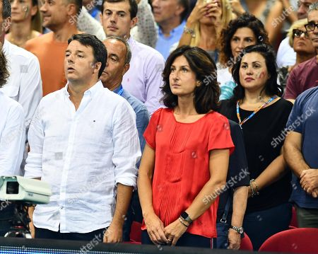 Former Italian Prime Minister Matteo Renzi (L) with his wife Agnese Landini (R) during the FIVB Men's World Championship First Round Pool A match between Italy and Argentina at the Mandela Forum in Florence, Italy, 15 September 2018.