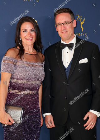 Stock Picture of Courteney Monroe and Geoff Daniels