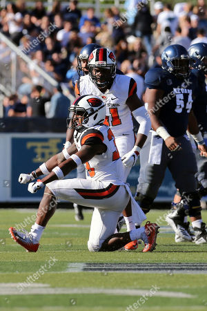 Oregon State Jalen Moore (33) celebrates a solo stop against Nevada during an NCAA college football game, in Reno, Nev
