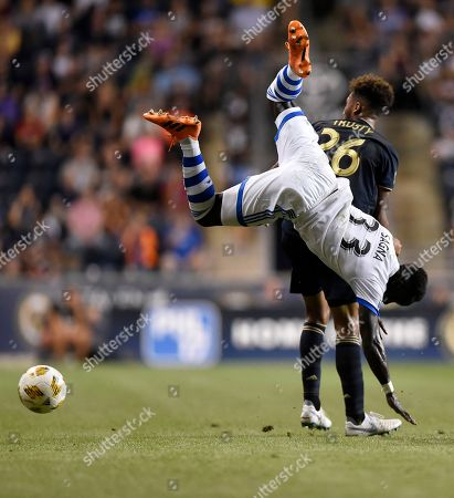 Montreal Impact's Bacary Sagna (33) and Philadelphia Union's Auston Trusty (26) collide in the first half of an MLS soccer match, in Chester, Pa