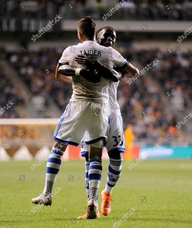 Montreal Impact's Saphir Taider (8) scores a goal and celebrates with Bacary Sagna (33) in the first half of an MLS soccer match, in Chester, Pa