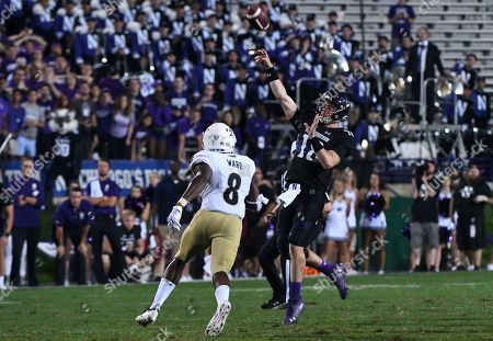 """Northwestern quarterback Clayton Thorson (18) shows a """"Hail Mary"""" pass while being defended by Akron linebacker Josh Ward (8) during the second half of an NCAA college football game in Evanston, Ill"""
