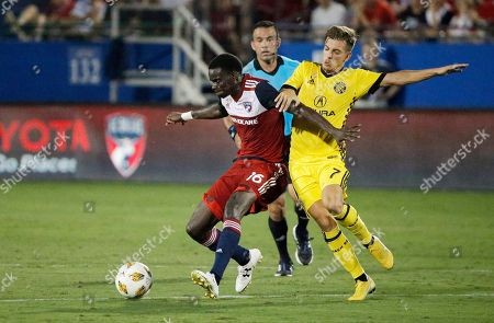 FC Dallas forward Dominique Badji (16) battles Columbus Crew midfielder Pedro Santos (7) for possession of the ball during the second half of an MLS soccer match, in Frisco, Texas. The game ended 0-0