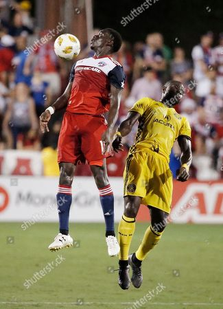FC Dallas forward Dominique Badji, left, plays the ball off of his chest as Columbus Crew defender Jonathan Mensah, right, defends during the first half of an MLS soccer match, in Frisco, Texas