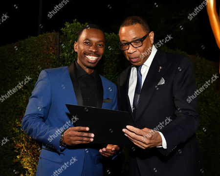 Melvin Jackson Jr., Hayma Washington. Emmy nominee Melvin Jackson Jr., left, poses with Television Academy Chairman and CEO Hayma Washington at the 2018 Performers Nominee Reception presented by the Television Academy at the Wallis Annenberg Center for the Performing Arts, in Beverly Hills, Calif