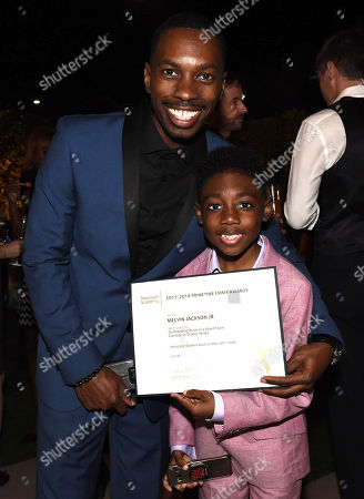 Melvin Jackson Jr., Christian Isaiah. Melvin Jackson Jr., left, and Christian Isaiah attend the 2018 Performers Nominee Reception presented by the Television Academy at the Wallis Annenberg Center for the Performing Arts, in Beverly Hills, Calif