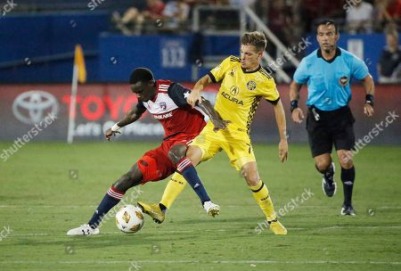 PHOTO. FC Dallas forward Dominique Badji, left, battles Columbus Crew midfielder Pedro Santos (7) for possession of the ball during the second half of an MLS soccer match, in Frisco, Texas. The game ended 0-0