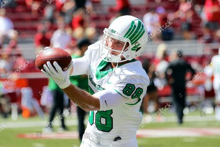 North Texas wide receiver Jason Pirtle #88 looks in a ball during pre game warm ups. North Texas defeated Arkansas 44-17 at Donald W. Reynolds Stadium in Fayetteville, AR, Richey Miller/CSM