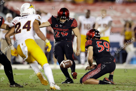 San Diego State place kicker John Baron II, center, kicks a 54-yard field goal during the second half of an NCAA college football game against Arizona State, in San Diego