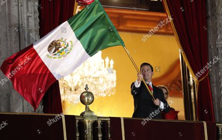 Mexican President Enrique Pena Nieto participates during Independence Day in Mexico City, Mexico, 15 September 2018. Pena Nieto and his wife Angelica Rivera appeared at the central balcony of the National Palace of Mexico City, headquarters of the Executive, which looks onto the Constitution Square to participate in the event for the last time as President.