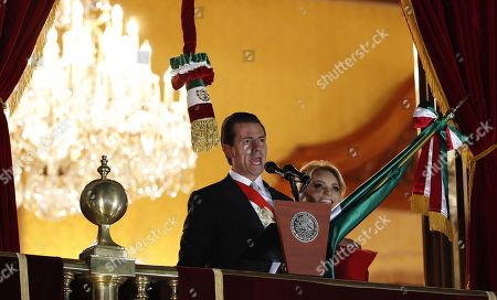 Stock Image of Mexican President Enrique Pena Nieto (L) speaks during Independence Day in Mexico City, Mexico, 15 September 2018. Pena Nieto and his wife Angelica Rivera appeared at the central balcony of the National Palace of Mexico City, headquarters of the Executive, which looks onto the Constitution Square to participate in the event for the last time as President.