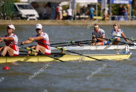 Czech Republic's Kristyna Fleissnerova, left, and Lenka Antosova pause after winning in the final of the Women's Double Skulls at the World Rowing Championships in Plovdiv, Bulgaria