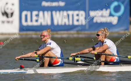 Stock Photo of Czech Republic's Kristyna Fleissnerova, left, and Lenka Antosova pause after winning in the final of the Women's Double Skulls at the World Rowing Championships in Plovdiv, Bulgaria