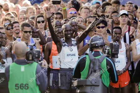Wilson Kipsang waves prior to the start of the 45th Berlin Marathon in Berlin, Germany