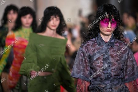Models on the catwalk - Designed by A Sai Ta