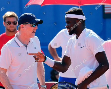 Frances Tiiafoe (R) and head Coach Jim Courier (L) of USA talk during the the Davis Cup semi final tie between Croatia and the USA in Zadar, Croatia, 16 September 2018.
