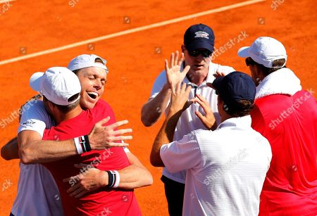 Sam Querrey  (L) and Head Coach Jim Courier (2ns L) of the USA celebrate winning against  Marin Cilic of Croatia during the Davis Cup semi final tie between Croatia and the USA in Zadar, Croatia, 16 September 2018.