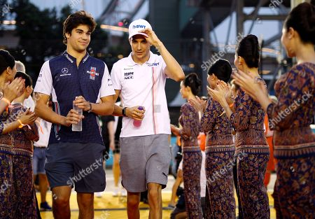 Canadian Formula One driver Lance Stroll of Williams and French Formula One driver Esteban Ocon of Sahara Force India F1 Team attend the drivers' parade before the Singapore Formula One Grand Prix at the Marina Bay Street Circuit in Singapore, 16 September 2018.