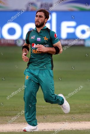 Pakistan's Usman Khan runs to celebrate the dismissal of Hong Kong's Tanvir Afzal during the one day international cricket match of Asia Cup between Pakistan and Hong Kong in Dubai, United Arab Emirates
