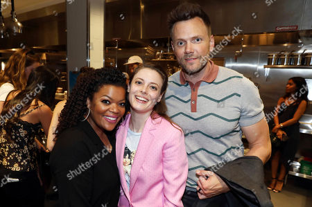 Stock Image of Yvette Nicole Brown, Gillian Jacobs, Joel McHale. Yvette Nicole Brown, left, Gillian Jacobs, center, and Joel McHale pose for a photo at the star studded grand opening of Simone in the Arts District, in Los Angeles